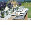 Outdoor-wedding-reception-centerpieces-mason-jars-purple-wedding-flowers.square