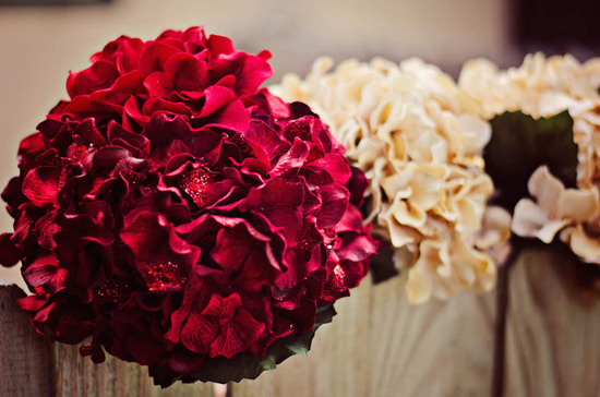 Deep red and ivory wedding flower arrangements