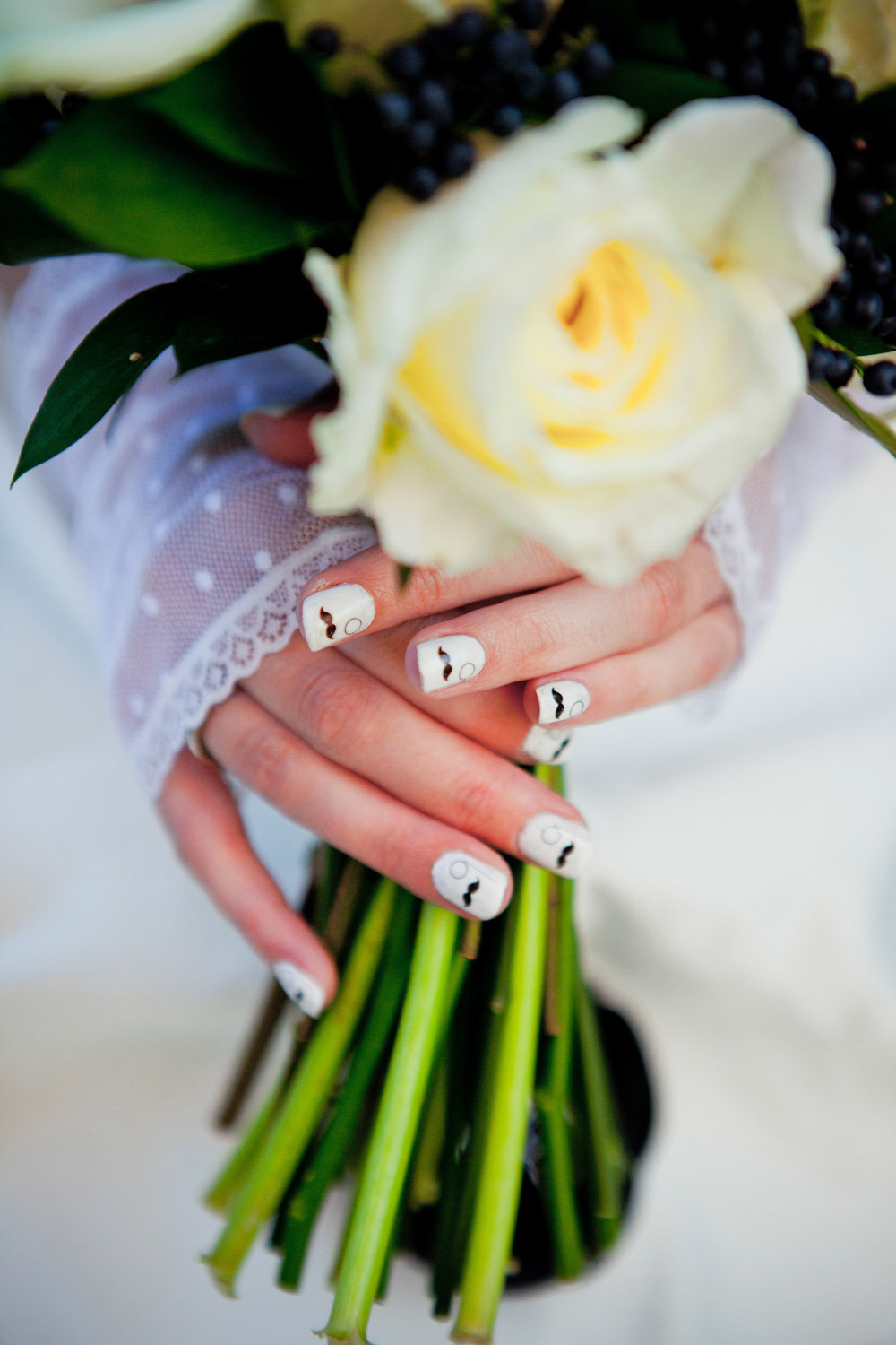 Awesome-bridal-manicure-white-with-mustache-decals.full