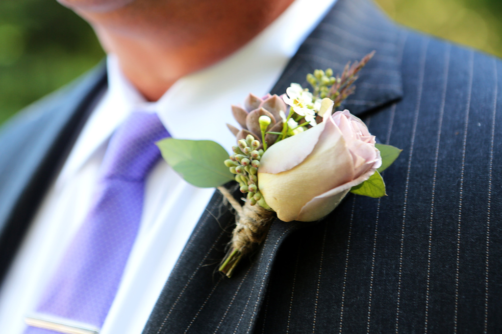 Classic groom wears pin striped suit lavender tie