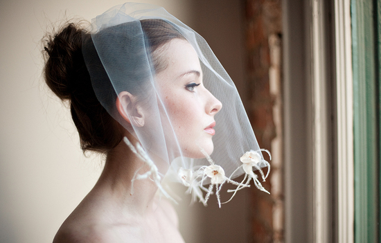 Shoulder length wedding veil with feather trim