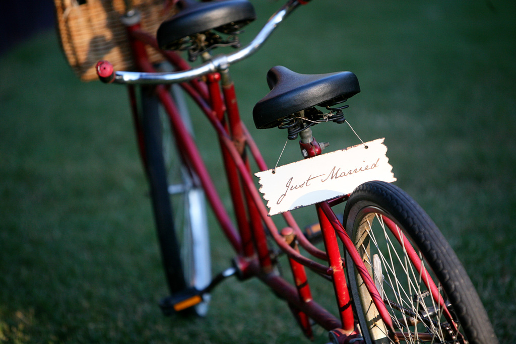 Red-bike-adorned-with-just-married-sign.full