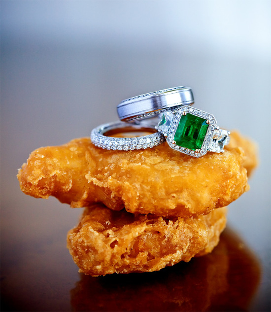 Emerald green engagement ring with wedding bands and nuggets