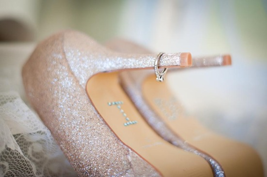 Sparkly blush wedding shoes with engagement ring on heel