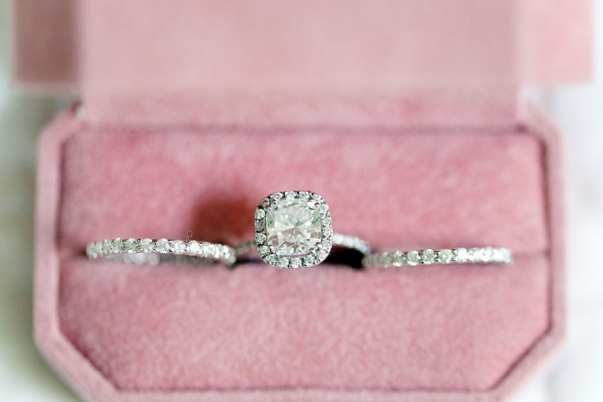 Cushion cut engagement ring with two diamond wedding bands