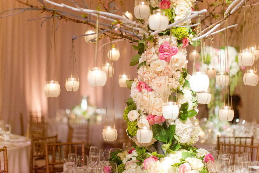 Dramatic wedding centerpiece with branches and hanging votives