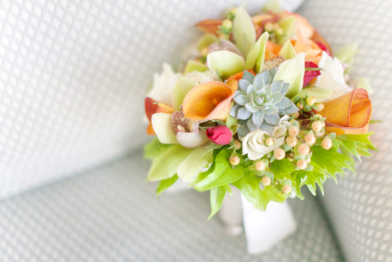 tropical wedding bouquet with a single succulent in the center