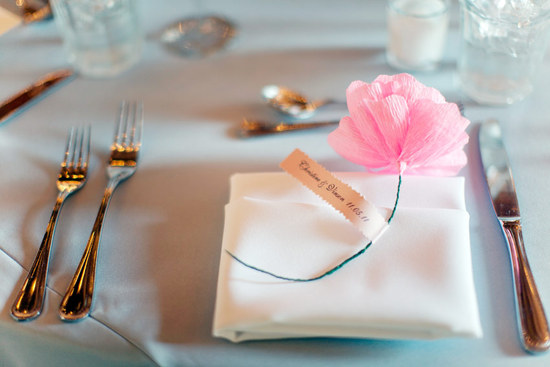 Pink paper flower as a wedding guest favor