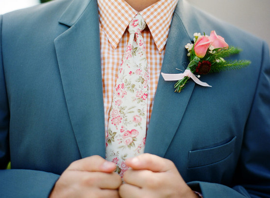 Unique grooms attire with a floral print tie