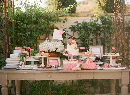 Delightful wedding sweets table at outdoor vintage reception