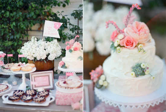 Romantic wedding cake topped with pink roses and succulents