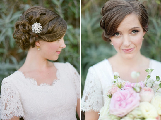 Classic curly wedding updo finished with a brooch