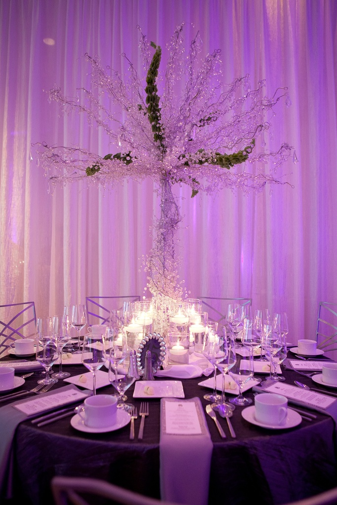 photo of glamourous wedding reception table high non floral centerpiece