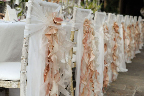 Rose gold ruffly wedding chair covers