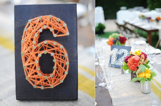 photo of yarn table numbers wedding reception