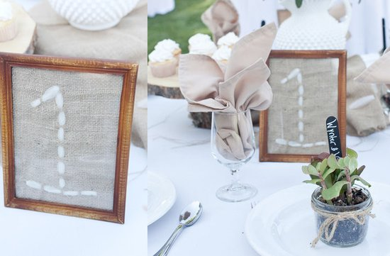 photo of unique wedding reception table number ideas stitching burlap