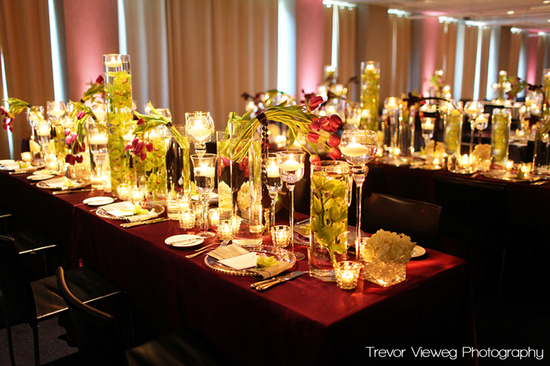 Modern elegance wedding reception table with lots of candlelight