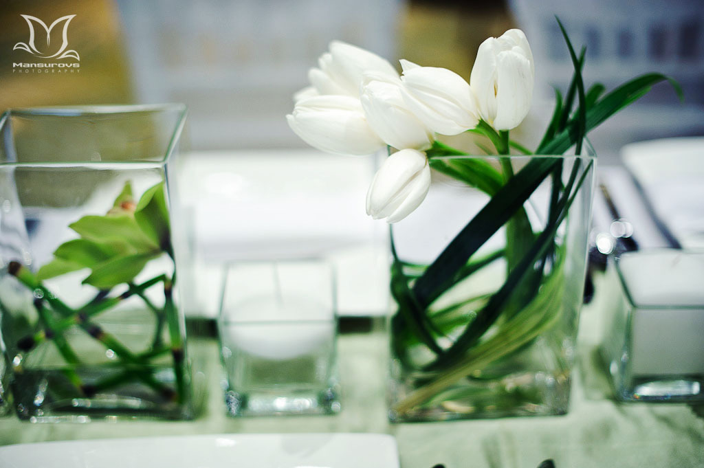 Modern white and green wedding centerpieces