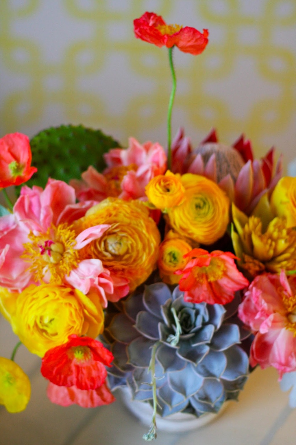 Bright wedding centerpiece with peonies ranunculus and garden roses