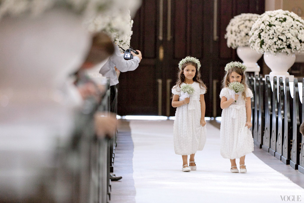 Adorable-flower-girls-with-babys-breath-crowns-walk-ceremony-aisle.full