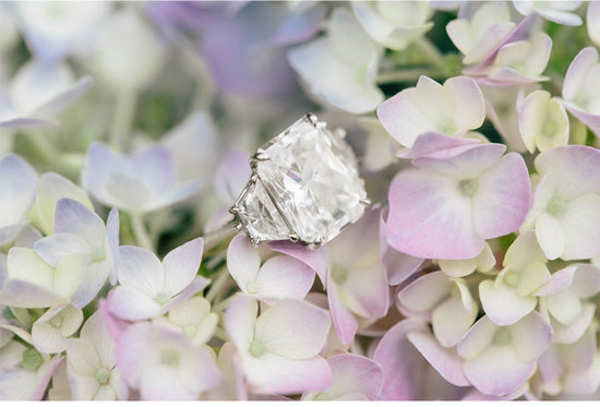 Light lilac and hydrangea cream wedding flowers with engagement ring