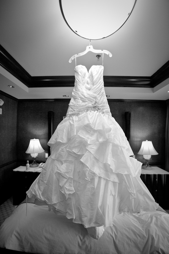 white wedding dress hangs in las vegas wedding venue
