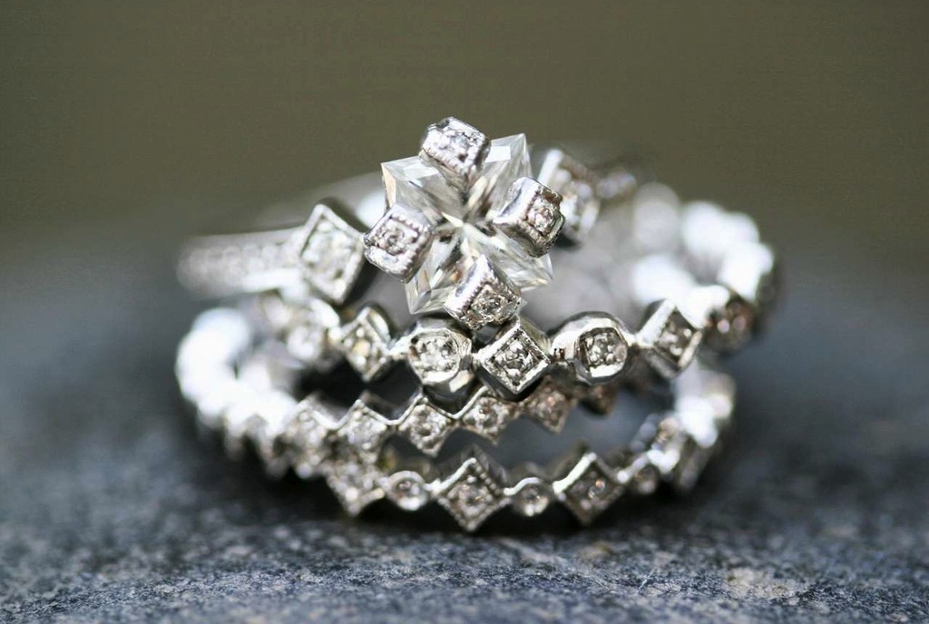 Vintage-inspired-engagement-ring-with-matching-cathy-waterman-wedding-bands.full