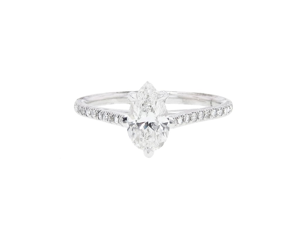 Pear shaped diamond engagement ring with pave band