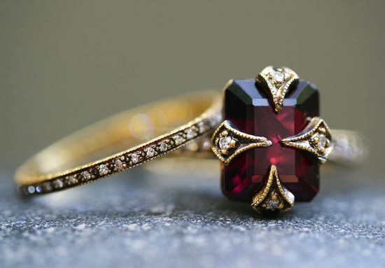 Garnet engagement ring with coordinating yellow gold wedding band