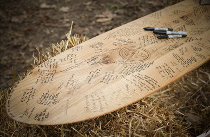Surf-board-wedding-guest-book-outdoor-real-weddings.full
