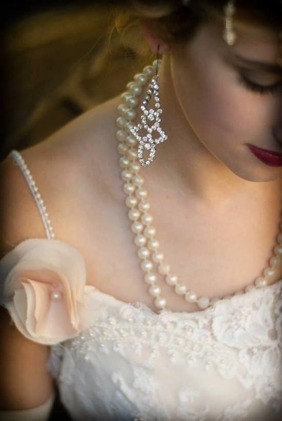 Vintage bride wears pearl necklace crystal chandelier earrings