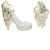 Offbeat-bridal-style-quilted-white-wedding-shoes-applique.square