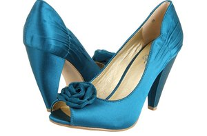 photo of seychelles satin blue wedding shoes chunky heel rosette detail