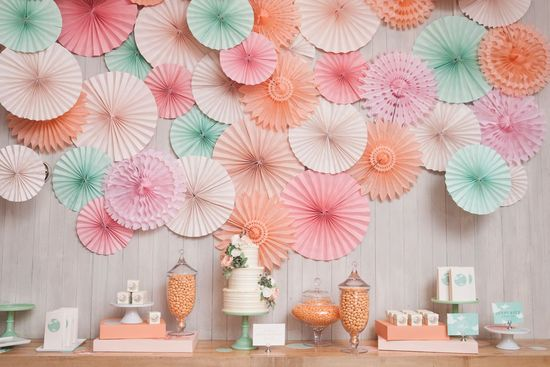 photo of Pastel wedding backdrop behind reception cake sweets table