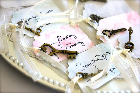 Pastel watercolor escort cards with skeleton keys