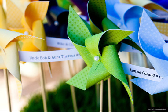 Colorful pinwheel wedding escort cards