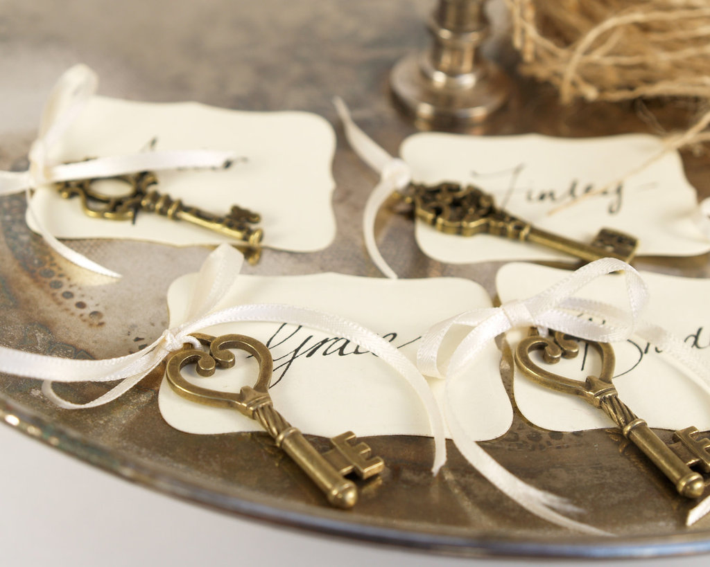 Elegant ivory escort cards with vintage key attached