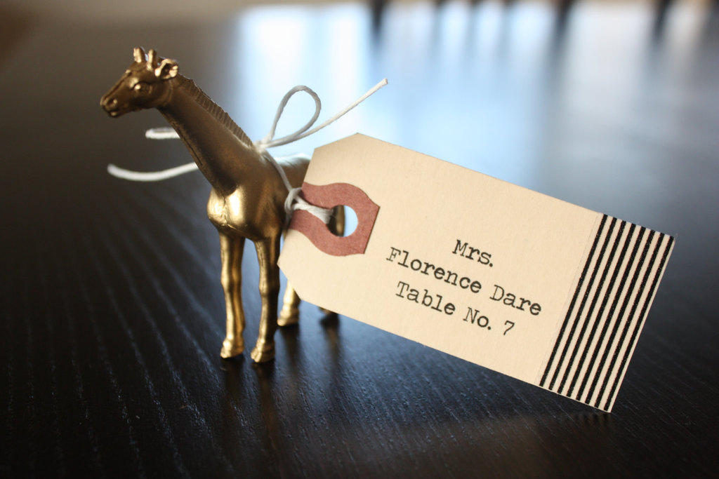 Vintage-style-wedding-escort-card-attached-to-gold-mini-horse.full