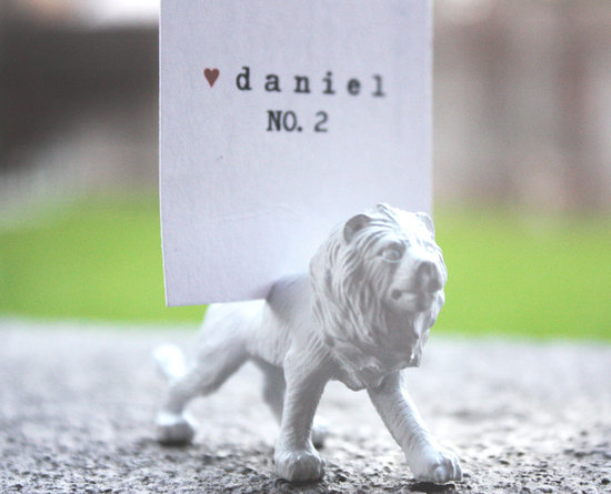Handmade wedding escort card with white white lion stand