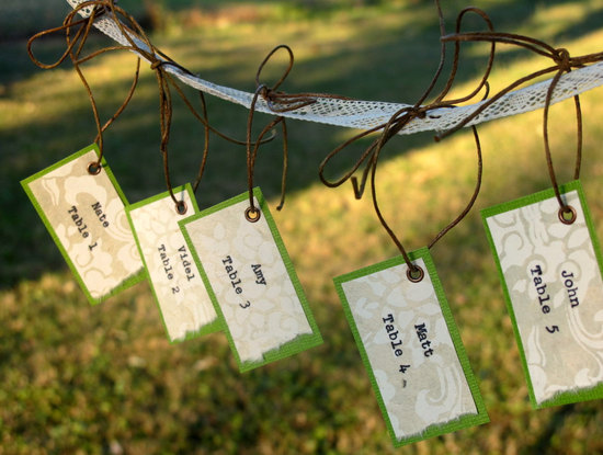 rustic handmade wedding escort cards with leather tie