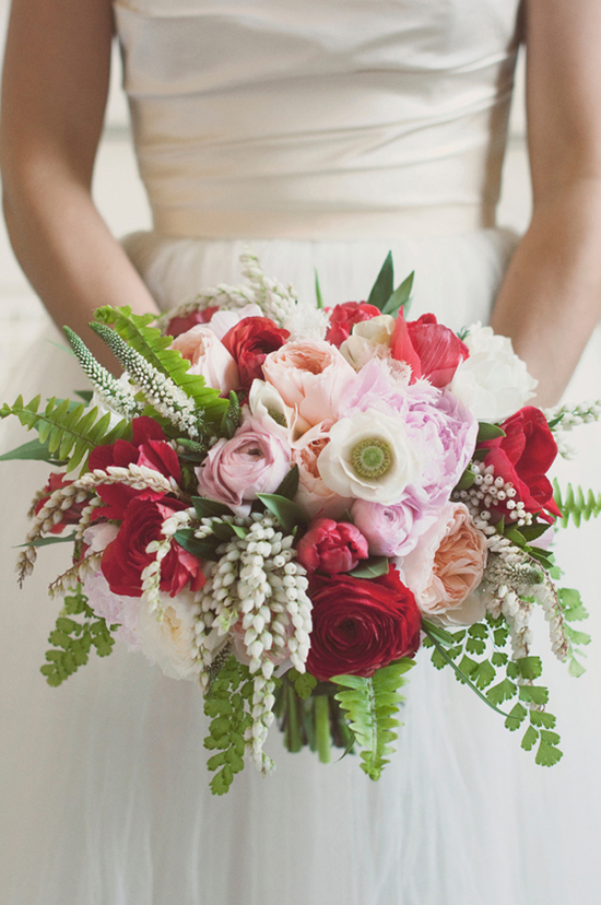 Romantic bridal bouquet in red, pink, and ivory