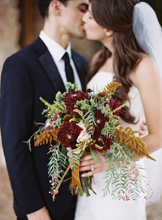 Wedding bouquet and centerpiece in rich fall hues