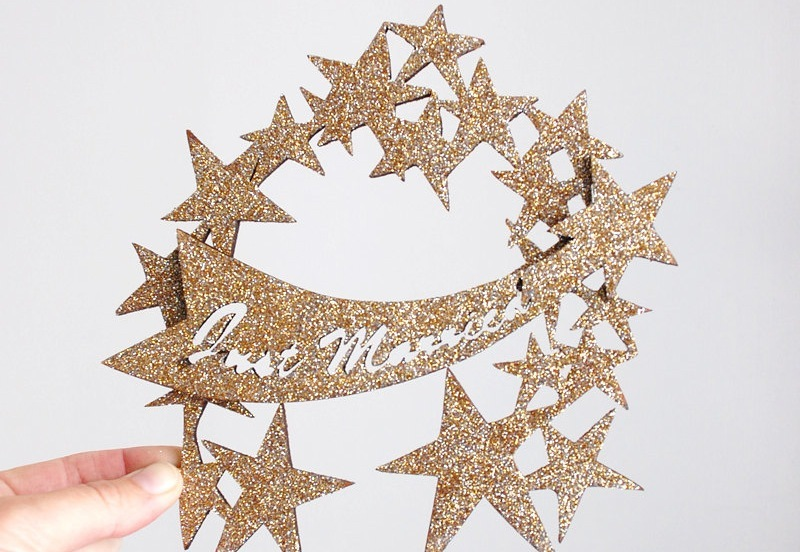 Glittery-gold-just-married-wedding-cake-topper.full