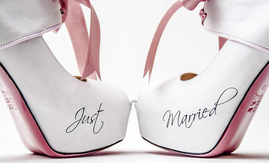 White wedding shoes with Just Married scrolled on the side