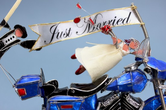Unique motorcycle wedding cake topper with Just Married flag
