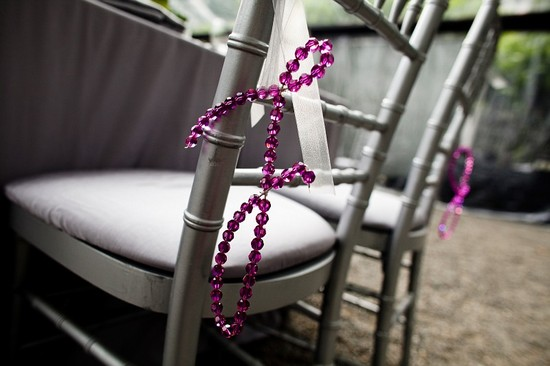 Purple beaded bride and groom initials for reception chairs