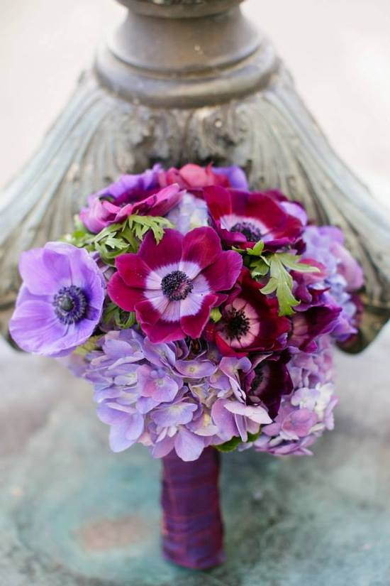 photo of Bright purple and wine wedding flower bouquet
