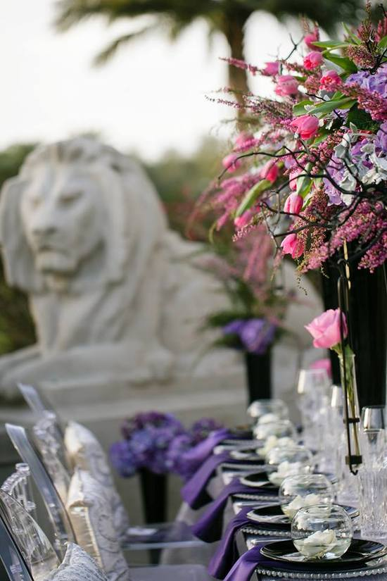 Romantic high wedding reception centerpieces in black vases