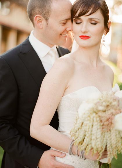 photo of Bright orange lipstick on classic bride