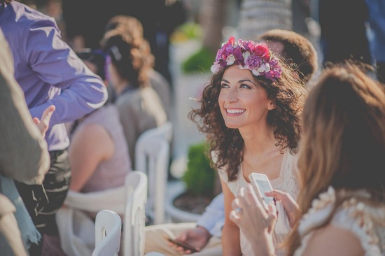 bohemian bride wears bright floral crown